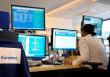 Euronext sera introduit en Bourse vendredi à un prix de 20 euros par action, confirme jeudi soir l'opérateur boursier. /Photo d'archives/REUTERS/Philippe Wojazer