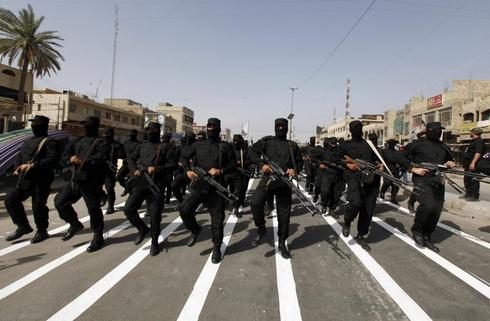 Iraq militants take Syria border post in drive for caliphate