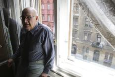 Resident Tamas Marton, 84, stands at the window of his apartment in a building where the Open Society Archives organises a Holocaust commemoration in downtown Budapest, June 21, 2014. REUTERS/Marton Dunai