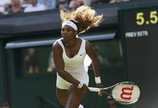 Serena Williams of the U.S. hits a return during her women's singles tennis match against Anna Tatishvili of the U.S. at the Wimbledon Tennis Championships, in London June 24, 2014. REUTERS/Suzanne Plunkett