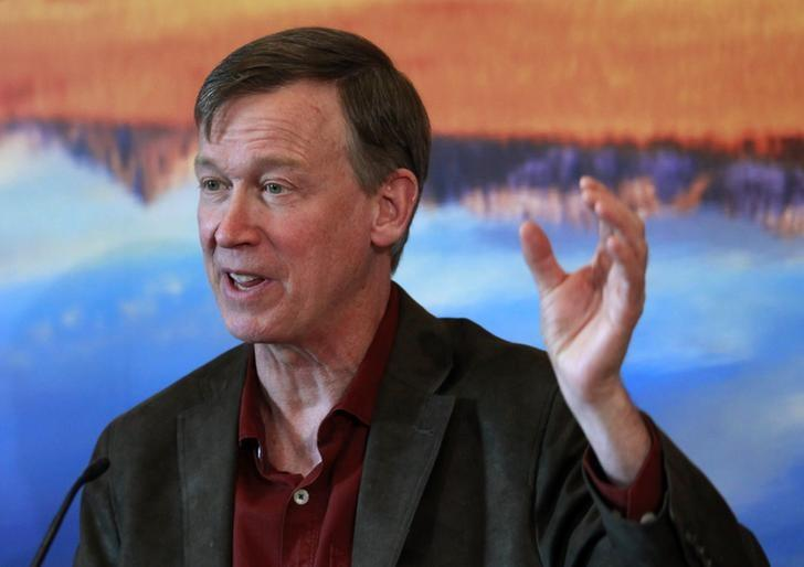 Colorado Governor John Hickenlooper lays out his plans for the next state legislative session at a news conference in his office at the Capitol in Denver December 19, 2013. REUTERS/Rick Wilking