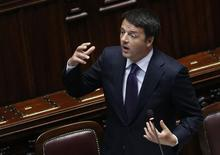 L'Italie a réduit d'un tiers son objectif de réduction des dépenses publiques. Le président du Conseil Matteo Renzi a sollicité de l'Union européenne plus de souplesse budgétaire. /Photo prise le 24 juin 2014/REUTERS/Remo Casilli