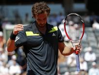 Ernests Gulbis of Latvia reacts during his men's semi-final match against Novak Djokovic of Serbia at the French Open tennis tournament at the Roland Garros stadium in Paris June 6, 2014.  REUTERS/Gonzalo Fuentes