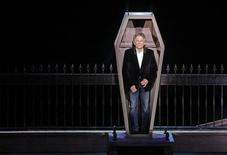 """Polish-French film director Roman Polanski stands inside a coffin as he takes part in the presentation of the musical """"Le Bal des Vampires"""" (Dance of the Vampires) at the Mogador theater in Paris March 17, 2014. REUTERS/Jacky Naegelen"""