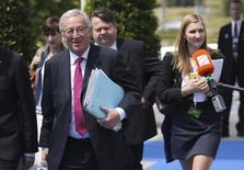Les dirigeants européens ont désigné vendredi Jean-Claude Juncker, vétéran des institutions communautaires, comme candidat à la présidence de la Commission malgré l'opposition farouche et jusqu'à la dernière minute du Britannique David Cameron. /Photo prise le 26 juin 2014/REUTERS/François Lenoir