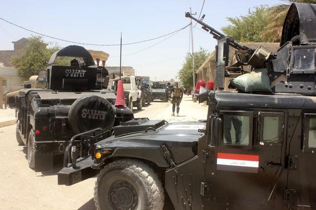 6月26日、今週バークレイズが発表した調査では、投資家たちは、向こう1年の金融市場で最も重大なリスクを地政学だと考えていることが分かった。写真はイラクの治安部隊。ディヤラ州で撮影(2014年 ロイター)