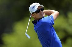 Jun 28, 2014; Bethesda, MD, USA; Justin Rose hits his tee shot on the second  hole during the third round of the Quicken Loans National golf tournament at Congressional Country Club - Blue Course. Mandatory Credit: Tommy Gilligan-USA TODAY Sports - RTR3W7Q8