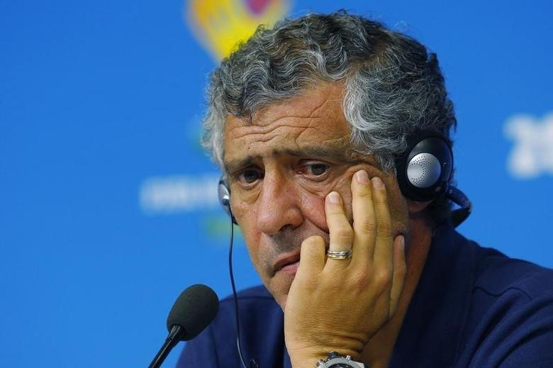 Fernando Santos listens to a question at a news conference at the Pernambuco arena in Recife, June 28, 2014.    REUTERS/Brian Snyder