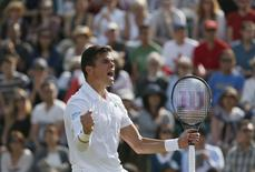 Milos Raonic of Canada reacts after defeating Kei Nishikori of Japan in their men's singles tennis match at the Wimbledon Tennis Championships, in London July 1, 2014.  REUTERS/Stefan Wermuth