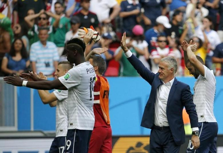 France's coach Didier Deschamps (R) celebrates with his players after winning their 2014 World Cup round of 16 game against Nigeria at the Brasilia national stadium in Brasilia June 30, 2014. REUTERS/Jorge Silva