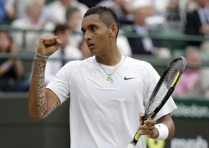 Nick Kyrgios of Australia reacts during his men's singles quarter-final tennis match against Milos Raonic of Canada at the Wimbledon Tennis Championships, in London July 2, 2014.           REUTERS/Max Rossi