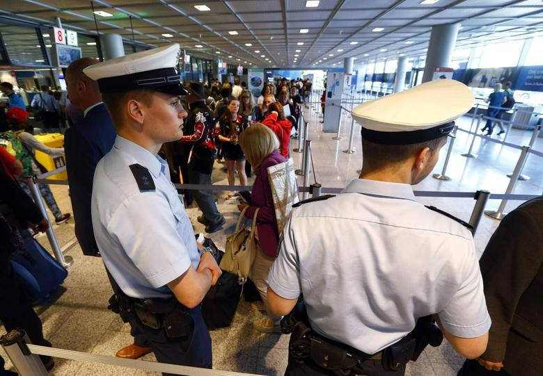 Police officers patrol at a security gate inside the main terminal of Frankfurt Airport July 3, 2014.   REUTERS/Ralph Orlowski