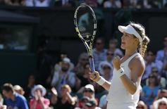 Eugenie Bouchard of Canada reacts after defeating Simona Halep of Romania in their women's singles semi-final tennis match at the Wimbledon Tennis Championships, in London July 3, 2014. REUTERS/Stefan Wermuth