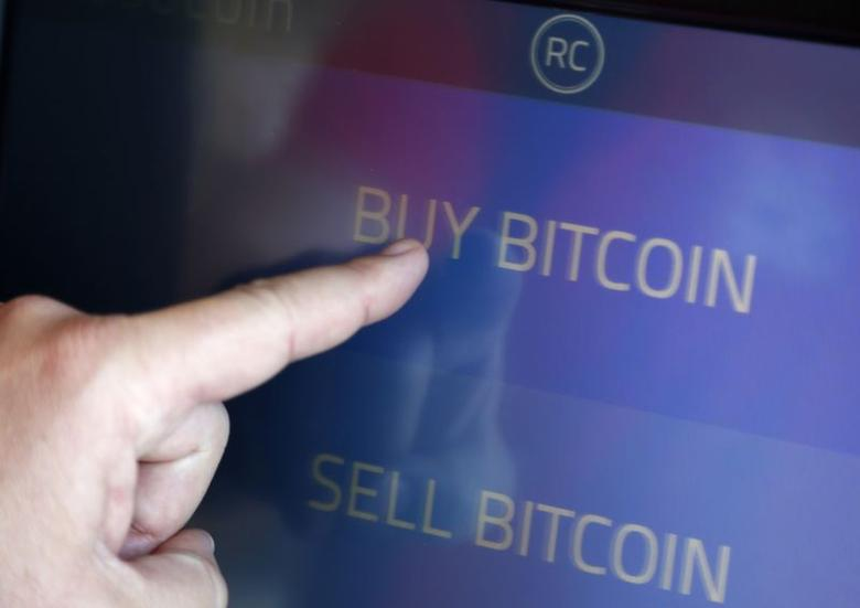 The screen of Southern California's first two bitcoin-to-cash ATMs which began operating today, is seen in Locali Conscious Convenience store in Venice, Los Angeles, California, June 21, 2014. REUTERS/Lucy Nicholson/Files