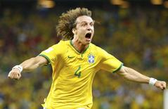 Brazil's David Luiz celebrates after scoring a goal against Colombia during the 2014 World Cup quarter-finals soccer match at the Castelao arena in Fortaleza July 4, 2014.   REUTERS/Stefano Rellandini