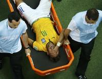 Brazil's Neymar grimaces as he is carried off the pitch after being injured during their 2014 World Cup quarter-finals against Colombia at the Castelao arena in Fortaleza July 4, 2014.       REUTERS/Fabrizio Bensch