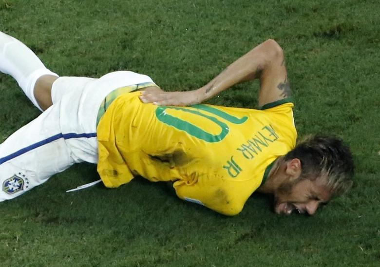 Brazil's Neymar grimaces in pain after a challenge by Colombia's Camilo Zuniga during their 2014 World Cup quarter-final match at the Castelao arena in Fortaleza July 4, 2014.            REUTERS/Fabrizio Bensch