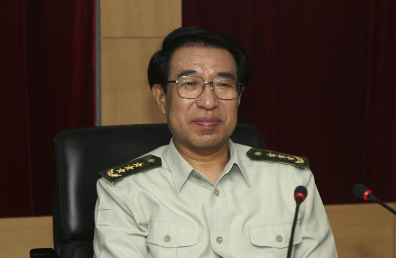 Then member of Central Military Commission Xu Caihou attends a meeting in Changchun, Jilin province July 14, 2004. REUTERS/Stringer