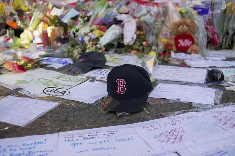 A Boston Red Sox hat is seen among a makeshift memorial for the victims of the Boston Marathon bombings on Boylston street in Boston, Massachusetts April 18, 2013.     REUTERS/Shannon Stapleton