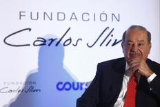 Mexican billionaire Carlos Slim attends a presentation of a digital platform, which was created in partnership with the Carlos Slim Foundation and online course platform Coursera, inside Soumaya museum in Mexico City January 29, 2014.  REUTERS/Edgard Garrido