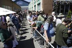 People wait in the heat to enter Cannabis City during the first day of legal retail marijuana sales in Seattle, Washington July 8, 2014. REUTERS/Jason Redmond