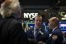 Traders work on the floor of the New York Stock Exchange July 8, 2014. REUTERS/Brendan McDermid