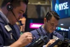Traders work on the floor of the New York Stock Exchange May 21, 2014. REUTERS/Brendan McDermid