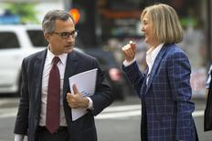 Georges Dirani (L), general council for BNP Paribas, arrives with Karen Patton Seymour before entering U.S. District Court for the Southern District of New York in Lower Manhattan July 9, 2014. REUTERS/Lucas Jackson