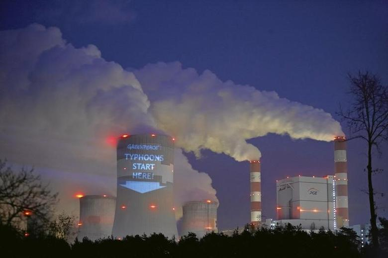 A slogan is projected by Greenpeace activists on a cooling tower of Belchatow Power Station, Europe's largest coal-fired power plant, in Belchatow November 9, 2013. REUTERS/Tomasz Stanczak/Agencja Gazeta
