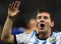 Jogador argentino Lionel Messi comemora a vitória sobre a Holanda nos pênaltis que garantiu a presença de seu time na final da Copa do Mundo, na Arena Corinthians, em São Paulo. 10/07/2014.  REUTERS/Dylan Martinez