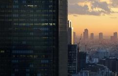 High-rise office buildings are seen during sunset in Tokyo December 10, 2013. REUTERS/Toru Hanai