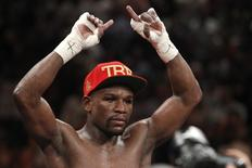 Floyd Mayweather Jr. of the U.S. celebrates his victory over Marcos Maidana of Argentina following their WBC/WBA welterweight unification fight at the MGM Grand Garden Arena in Las Vegas, Nevada, May 3, 2014.  REUTERS/Steve Marcus/Files
