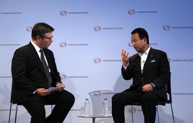 Japan's Economics Minister Akira Amari (R) talks with Reuters Japan Bureau Chief Kevin Krolick during a Thomson Reuters Newsmaker event in Tokyo July 11, 2014. REUTERS/Toru Hanai