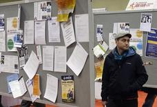 A man looks over job boards at the 2014 Spring National Job Fair and Training Expo in Toronto, April 3, 2014. REUTERS/Aaron Harris