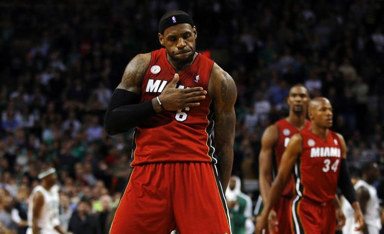 LeBron James reacts after making a basket to give the Heat the lead late in the second half against the Celtics in Boston, March 2013. REUTERS/Brian Snyder