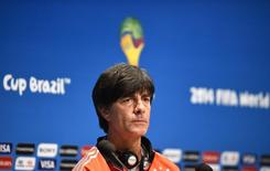 Germany's coach Joachim Loew listens to a question during a news conference at the Maracana stadium in Rio de Janeiro July 12, 2014, ahead of their 2014 World Cup Final soccer match against the Argentina on Sunday.    REUTERS/Dylan Martinez (BRAZIL  - Tags: SOCCER SPORT WORLD CUP)