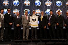 Jun 27, 2014; Philadelphia, PA, USA; Sam Reinhart poses for a photo with team officials after being selected as the number two overall pick to the Buffalo Sabres in the first round of the 2014 NHL Draft at Wells Fargo Center. Mandatory Credit: Bill Streicher-USA TODAY Sports