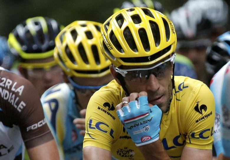 Astana team rider Vincenzo Nibali of Italy reacts as he cycles in the pack during the 170-km ninth stage of the Tour de France cycling race between Gerardmer and Mulhouse July 13, 2014.         REUTERS/Christian Hartmann