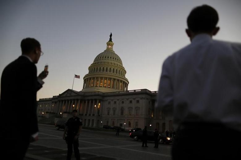 Night falls over the U.S. Capitol Dome, as members of the Republican-controlled U.S. House of Representatives deal with a budget showdown with the Democratic-controlled U.S. Senate, and a possible government shutdown in Washington, September 30, 2013.  REUTERS/Jonathan Ernst