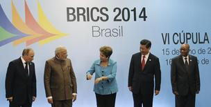(L-R) Russian President Vladimir Putin, Indian Prime Minister Narendra Modi, Brazilian President Dilma Rousseff, Chinese President Xi Jinping and South African President Jacob Zuma talk at a group photo session during the 6th BRICS summit in Fortaleza July 15, 2014. REUTERS/Nacho Doce