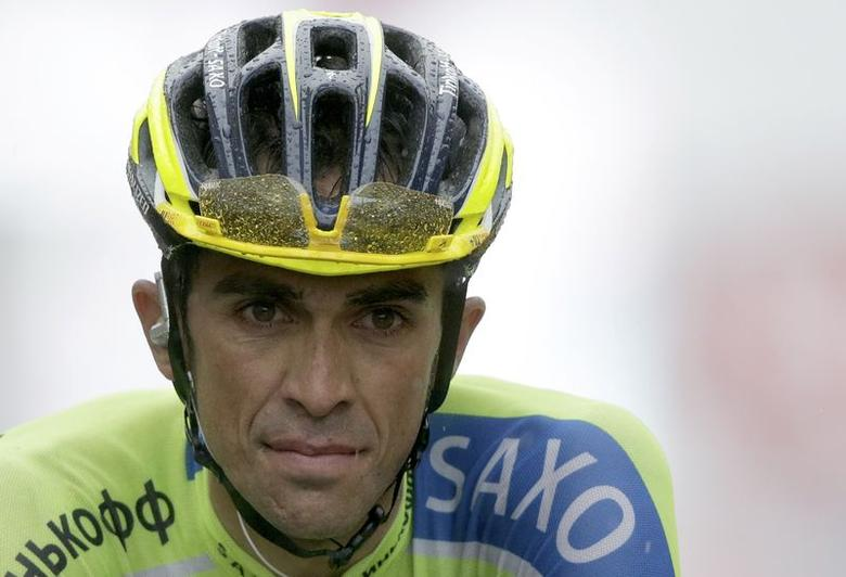 Tinkoff-Saxo team rider Alberto Contador of Spain crosses the finish line of the 161-km (100 miles) eighth stage of the Tour de France cycling race between Tomblaine and Gerardmer La Mauselaine, July 12, 2014.      REUTERS/Jacky Naegelen