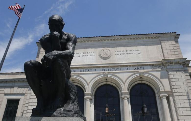 A bronze cast of ''The Thinker'' by sculptor Auguste Rodin sits in front of the Detroit Institute of Arts June 8, 2014. REUTERS/Rebecca Cook