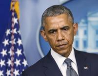 Президент США Барак Обама говорит о ситуации на Украине 18 июля 2014 года. Обама заявил в пятницу, что упавший накануне на Украине малайзийский авиалайнер был сбит над районом, контролируемым пророссийскими сепаратистами, и предупредил Москву о готовности ужесточить санкции.  REUTERS/Larry Downing