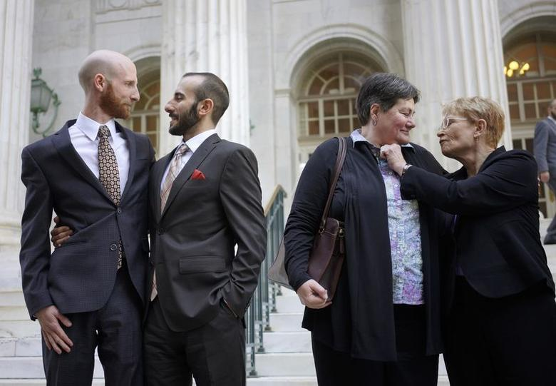 Plaintiffs Derek Kitchen (L-R) and Moudi Sbeity and Kate Call and Karen Archer talk outside the courthouse after a federal appeals court heard oral arguments on a Utah state law forbidding same sex marriage in Denver in an April 10, 2014 file photo. REUTERS/Rick Wilking/files