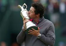Rory McIlroy of Northern Ireland kisses the Claret Jug after winning the British Open Championship at the Royal Liverpool Golf Club in Hoylake, northern England July 20, 2014.    REUTERS/Cathal McNaughton