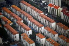 Apartment buildings are seen in a residential area at Pudong district in Shanghai August 2, 2013.  REUTERS/Carlos Barria