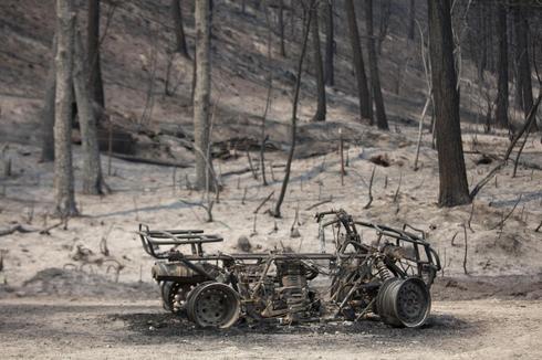 Crews make progress in calming massive Washington state wildfire