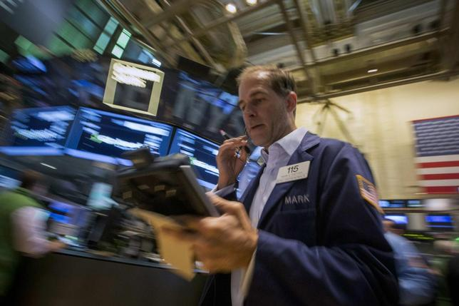 A trader works on the floor of the New York Stock Exchange July 18, 2014. REUTERS/Brendan McDermid