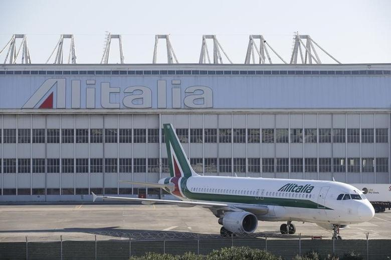 An Alitalia plane is parked on the tarmac at Fiumicino international airport in Rome December 10, 2013.REUTERS/Max Rossi
