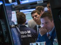 L'indice Dow Jones, plombé par le recul de l'action Boeing, a cédé 0,16% à la clôture mercredi, un chiffre susceptible d'évoluer encore légèrement. /Photo prise le 23 juillet 2014/REUTERS/Brendan McDermid